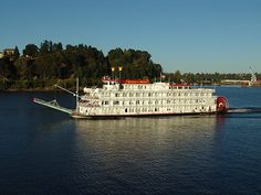 Queen of the West paddlewheel cruiseship. Every once in a while she cruises up the Willamette. Otherwise we enjoy the smaller sternwheelers and the other dinner cruise ships. Very pretty to see them go by at night, especially.
