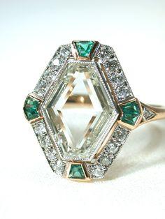 Portrait Diamond Ring - 2ct diamond polished into a flat plane with emeralds set into 18K. ca 1925