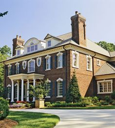 Georgian Revival Architecture Georgian revival architecture's perfect symmetry stamps this home with quintessential Southern character. The brick exterior features classic architecture made more authentic by antique chimney pots and coach lamps collected over the years.