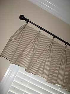 I like the simple look of these curtains. Nice lines. Pleated Valence made with Clip Rings
