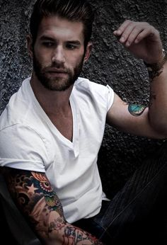 White tee, tats, and facial hair.  Doesn't take much more than that.