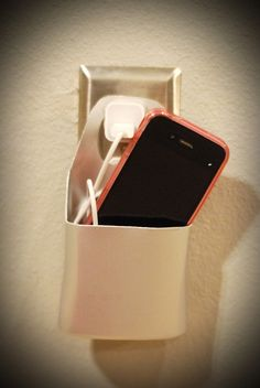 A holder for your charging cell phone made from an empty lotion bottle!  Success!!!