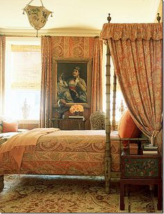 Bedroom with orange paisley wallcovering and fabrics -- Charlotte Moss