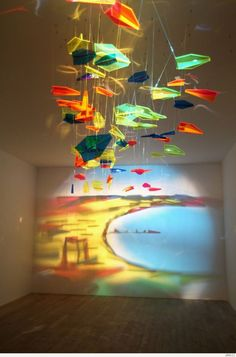 Artist Rashad Alakbarov of Azerbaijan uses suspended translucent objects and other found materials to create light and shadow paintings on walls.