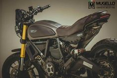 Scrambler modern tracker edit version by MUGELLO. Ducati Scrambler Custom, Scrambler Icon, Scrambler Motorcycle, Motorcycle Garage, Moto Ducati, Ducati Cafe Racer, Cafe Racers, Ducati Sport Classic 1000, Bike Details