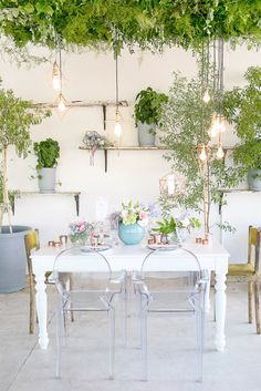 """One of the hottest wedding trends of 2016 is """"bringing the outdoors in"""" making use of lots of greenery for your wedding venue. We created a roof of greenery and added some beautiful modern geometric lighting in rose gold. - Veronique Photography"""