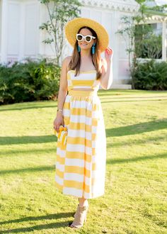 Jennifer Lake Style Charade in a Mara Hoffman yellow stripe midi dress, Sam Edelman Bailey stripe clutch, and a straw hat at Playa Grande Beach Club