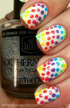 "Rainbow Dots - Base colour China Glaze ""White on White"". Dots - Wet'n'Wild ""Dreamy Poppy"", Barielle ""Gotta have Fate"", Zoya ""Pippa"", BYS ""Mint Condition"", Zoya ""Robyn"" & China Glaze ""Spontaneous""  Top coat of INM Northern Lights Silver Hologram"