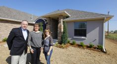 """Homebuilder Jay Evans of Two Structures Homes, with wife Tricia Evans and daughter Kelsey Evans, outside the """"House of Hope"""" fundraiser home at 841 SW 11 in Moore. It will be featured in the Parade of Homes Spring Festival, with homes open 1 to 7 p.m. May 2-4 and May 9-11.  Photos by Paul B. Southerland, The Oklahoman PAUL B. SOUTHERLAND -  PAUL B. SOUTHERLAND"""