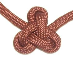 The Lambda Knot features three loops surrounding a triangular design in the center. This decorative knot can be used in Macrame jewelry projects, placing one on either side of beads, or standing alone.