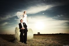 This is one of my favourite photos of an after wedding shooting on the north coast of germany in late summer.   Follow me on Instagram: https://www.instagram.com/phothomas.de/   #couple #bride #groom #weddingdress #summer #sky #portrait #weddingportrait #bridebook #angel #wings #field #nature #phothomas #photographer #wedding #oldenburg #rastede #bremen #fotograf #hochzeit #hochzeitsfotograf #weddingphotographer #thomasweber #germany