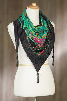 Meticulous beadwork and sequins turn this colorful viscose scarf into a work of art for an accessory that dazzles.