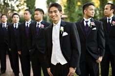 Make your groom stand out by wearing a differently-colored vest and tie from the groomsmen