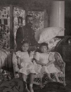 Nicholas with his two eldest children, Grand Duchess Olga (left) and Grand Duchess Tatiana.  This is most likely a family snapshot as both girls are casually dressed and sitting informally.