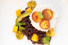 We're drooling over this Coconut Basmati Rice recipe with Black Beans, Plantains, and Mango Salsa. Get inspired by Caribbean flavors and show off your culinary skills with this tropical #recipe. #vegetarian #MeatlessMonday