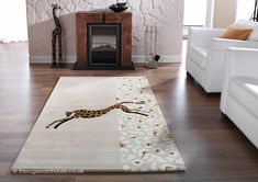 Jaguar Rug, a luxury hand-tufted mainly beige pure new wool jaguar themed rug with viscose highlights http://www.therugswarehouse.co.uk/modern-rugs3/kalahari-rugs/jaguar-rug.html #rugs #interiors