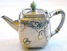 Tiffany & Co sterling silver and mixed-metals Japanesque teapot, with applied gourd and butterfly motifs, c1875