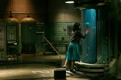 """A warm, generous spirit of affection and insurrection washes over Guillermo del Toro's dreamy """"The Shape of Water,"""" about a love between a mute cleaning lady (Sally Hawkins) and a merman (Doug Jones). Renoir, Elements Of Film, Water Movie, The Shape Of Water, Water Images, Black Lagoon, Film Stills, Martin Scorsese, Good Movies"""