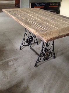 Great use of the top of an old coffee table mixed with the base from a singer sewing machine. Now it's a fantastic farmhouse style table, desk, or outside dining table