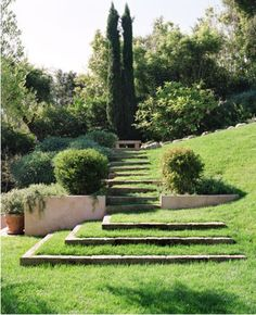 Precast with grassy steps. This is a great way to create base plane without dominating the space with hardscape.