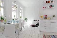 I love the all white look with bright colours & interesting trinkets placed here and there