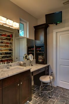 Master bathroom. Small cabinet for my side of sink. Love the shoe rack for the closet