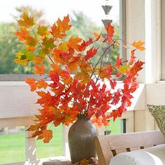 Simple yet gorgeous wedding decor - autumn leaves in a rustic vase -can use watering cans instead- LOVE THIS!!!