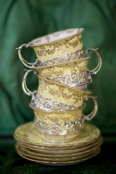 Cups have sterling silver trim and handles.