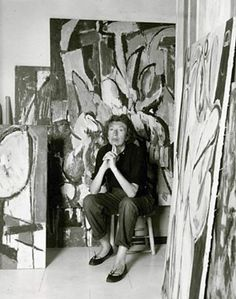 "Lee Krasner in her studio in 1956, two weeks after husband Jackson Pollock's death. Visible are her ""Prophecy"" (right) and ""Cauldron"" (unfinished, behind)."