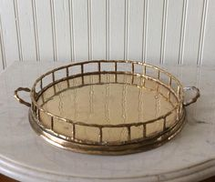 Vintage round brass bamboo tray with handles. Decorative tray for using on vanity, tabletop, bookshelf, barcart or kitchen decor! In very good vintage condition polished & ready to use. Use as I have to display small figurines or small tea for two serving tray Vintage brass cranes sold separately in shop!. Shipped insured! Measures 9 Round diameter x 11 handle to handle x 1.5 rim height Thanks for shopping YellowHouseDecor! Several brass trays of different sizes & shapes sold separa...