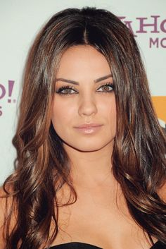 Mila Kunis rocking the caramel highlights.