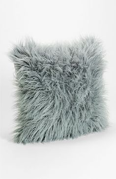 Nordstrom 'Flokati' Decorative Pillow | Nordstrom, $58; mix textures with pillows for tactile variety
