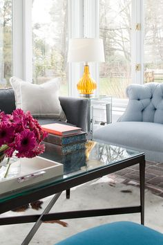 Pops of sophisticated color in a transitional living room
