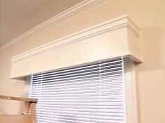 DIY window cornices - These DIY window cornices add polish to any room. You can get them for less money than you think! Learn how to build them yourself for 1/4 the price of store-bought cornices.