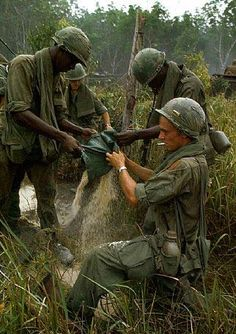 Soldiers of the 101st Airborne Division carry a wounded buddy through the jungle in May 1966. Description from 2eyeswatching.com. I searched for this on bing.com/images