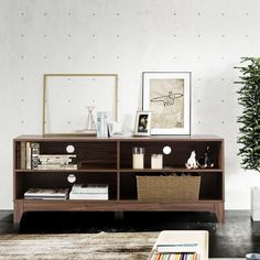 This is the great TV stand which can hold many audio video equipment or other sundries. The thicken legs are properly set in best place to support the frame of this TV stand. The stand tabletop is flat enough to hold many audio video equipment or other sundries. And you don't need to worry about the overheat of devices. The classic appearance and wood color also fit with modern atmosphere, even it can upgrade the level of your living room or recreation room.