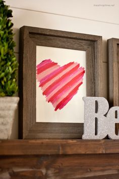 DIY Valentine's art made with lipstick ...love this! Super easy and cute