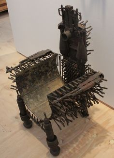 A chair made from old weapons