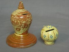 """A Whieldon style mushroom shaped money box 3"""" and 1 other standing pottery money box 6"""" £40-60"""