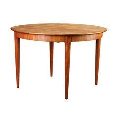 Tavolo tondo in teak anni 50,H.74 Ø.115+3x50 {codice tavt778}