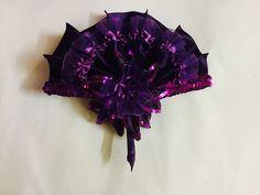 Purple ruffled hand fan