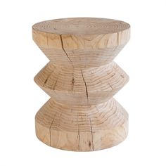 MARK TUCKEY zig zag side table. a solid block of radiata pine hand turned on a lathe into a simple ZIG ZAG form.