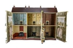 An unusual G & J Lines Wooden Dolls' House in Two Parts, of three bays, the right bay separate section, dummy front door with two lion head knockers, rosettes and two letter boxes, three bay windows across ground floor and three pairs of windows with balconies across first floor, stone and brick-paper facade, opening in three sections to reveal six rooms with fireplaces --42¾in. (108.5cm.) wide (G, mainly refurbished)