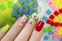 Colorful manicure design of square metal decorations on the nails neon colors.