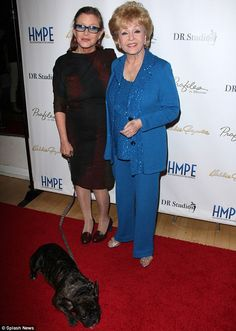 Carrie Fisher, looking beautiful, stylish & sleek, arrived with her dog Gary as she posed for pictures with her beautiful youthful looking 82 year old mother, Debbie Reynolds. May15, 2014, Hollywood.