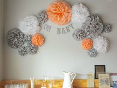 Steal these ideas for a gender-neutral baby shower. Tissue Paper Pom Poms Diy, Tissue Balls, Paper Poms, Paper Flowers, Baby Boy Shower, Peach Baby Shower, Gender Neutral Baby Shower, Elephant Baby Showers, Neutral Baby Colors