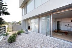 Designed by Architecture W, the Nagoya M House.  Transition to rooftop garden.