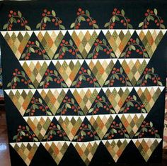 Cherry Basket quilt - lovely.  I has that diamond shape that I really like, and then appliqued cherries, leaves, etc.  Perfect!