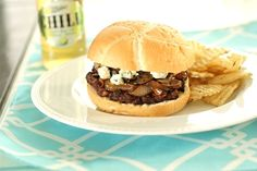 Blue Cheese Mushroom Burgers  4 beef patties, 1/4-1/3 pound each 4 hamburger buns 1 large yellow onion, very thinly sliced 2 cups sliced button mushrooms 2 ounces blue cheese 2 teaspoons worcestershire sauce salt peper olive oil 1/4 teaspoon sugar splash red wine dijon mustard