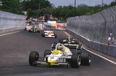 Keke Rosberg, Williams leads Nigel Mansell, Lotus